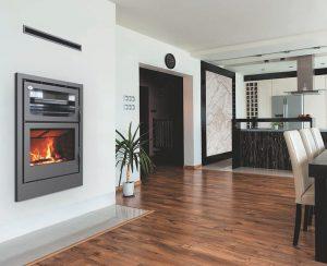 I Termocamini a legna Carbel con forno modello Vision riscaldano ambienti fino a 80-100 mq e consentono di cucinare al tempo stesso